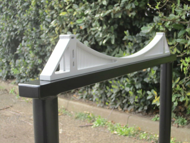 The Clifton suspension bridge if it were much smaller and fixed to the top of a bike stand.