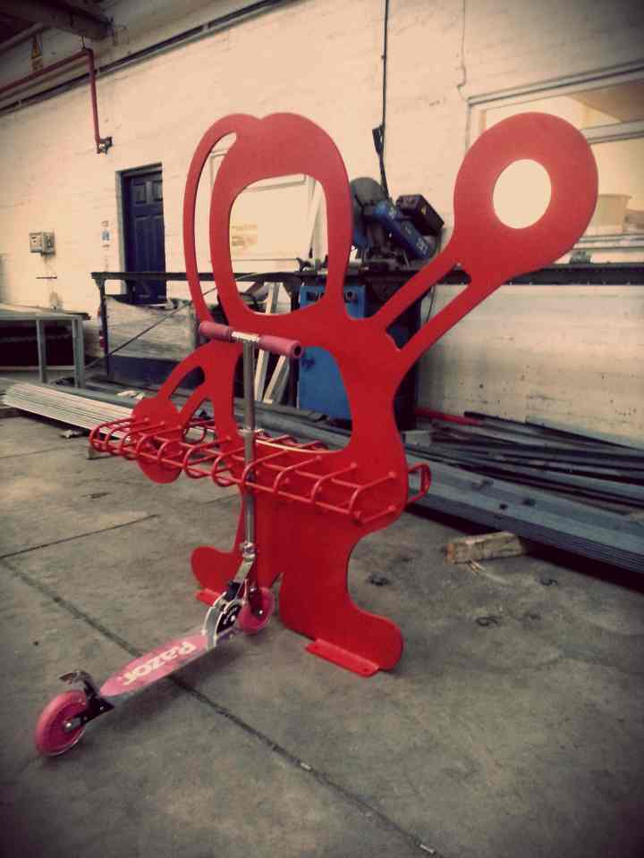 Spaceman scooter rack