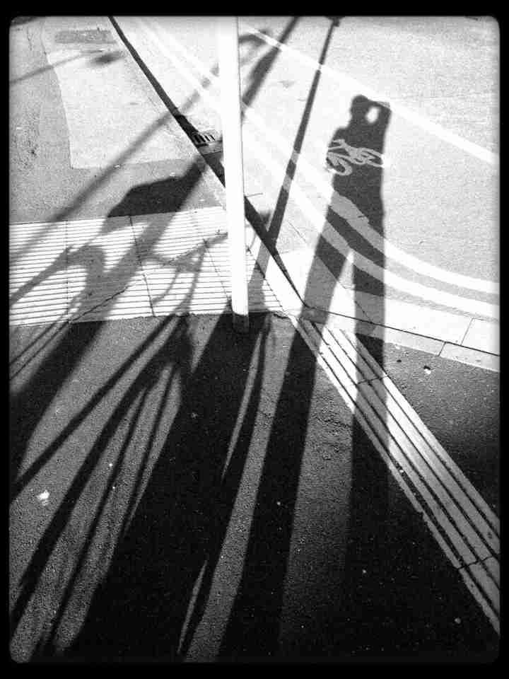Man, sign, bike, shadow
